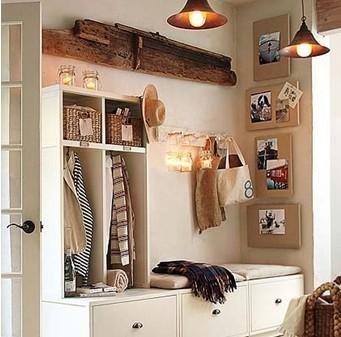 简单设计的入户玄关,白色的收纳柜和鞋柜的整体结合,给小户型家庭图片